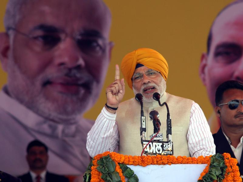 As PM, Modi practises 'dress diplomacy', choosing to sport the traditional clothes or headgear of the state he visits. At a rally  in Jagroan, Punjab, he is spotted in a saffron turban. However, in 2011, Modi came under fire for refusing to wear a skull cap presented to him by a Muslim cleric, during his Sadbhavna fast.  (Gurpreet Singh/Hindustan Times )