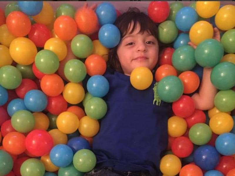 "Karan Johar shared this picture with the caption, ""My favourite boy celebrating my birthday"". Shah Rukh Khan's son AbRam enjoys his time at the party. (Instagram)"