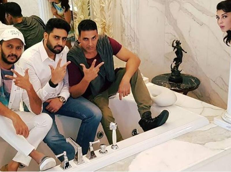 Don't miss Jacqueline peeping into the frame as Ritesh Deshmukh, Abhishek Bachchan and Akshay Kumar pose for a picture. (Instagram)