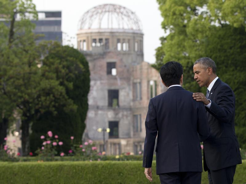 Obama and Abe speak with the Atomic Bomb Dome seen at rear. Obama on Friday became the first sitting US president to visit the site of the world's first atomic bomb attack, bringing global attention both to survivors and to his unfulfilled vision of a world without nuclear weapons.  (AP)