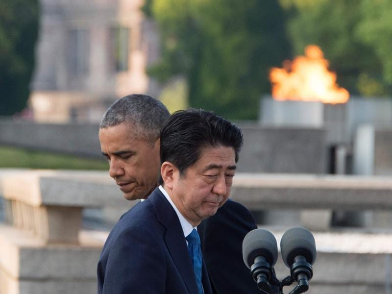 Abe (front R) prepares to speak following Obama made remarks after the two placed wreaths during a visit to the Hiroshima Peace Memorial Park in Hiroshima.  (AFP)
