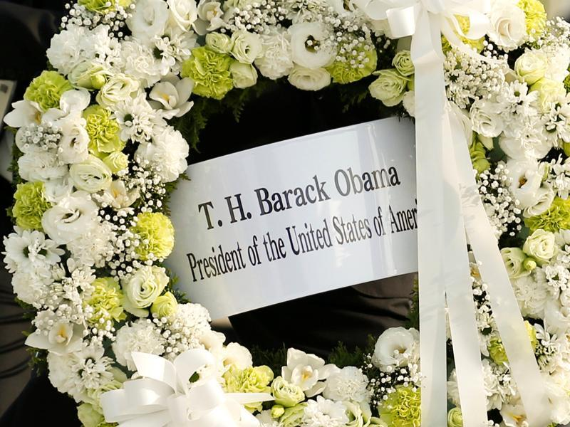 A picture shows the wreath Obama laid at a cenotaph at Hiroshima Peace Memorial Park. Even before it occurred, Obama's visit stirred debate, with critics accusing both the US and Japan of having selective memories, and pointing to paradoxes in policies relying on nuclear deterrence while calling for an end to atomic arms. (REUTERS)