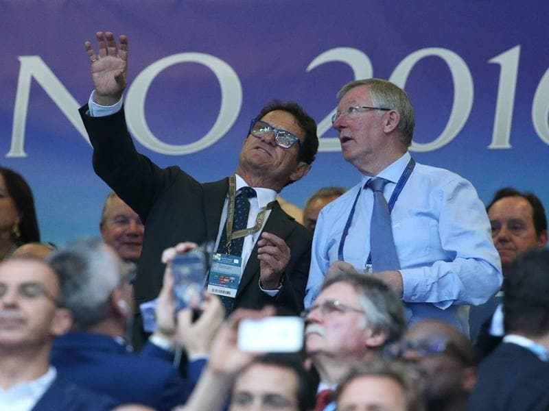 Fabio Capello and former Manchester United manager Sir Alex Ferguson sit in the stands. (Reuters Photo)