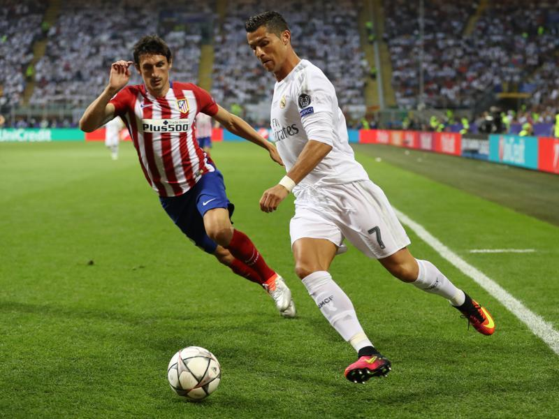 Real Madrid's Cristiano Ronaldo in action with Atletico Madrid's Stefan Savic in the first half of the Uefa Champions League final. (Reuters Photo)