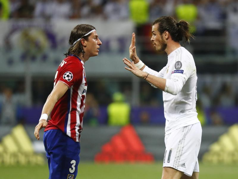 Atletico Madrid's Filipe Luis clashes with Real Madrid's Gareth Bale. (Reuters Photo)