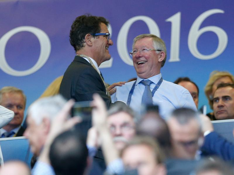Fabio Capello (left) and Sir Alex Ferguson share a laugh before the Champions League final football match between Real Madrid and Atletico Madrid. (AP Photo)