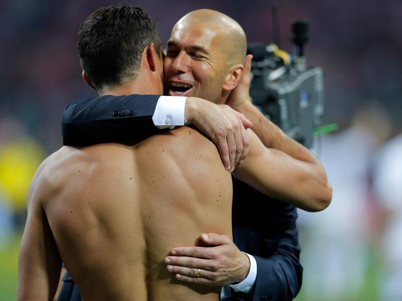 Real Madrid's Cristiano Ronaldo is embraced by Real Madrid's head coach Zinedine Zidane after scoring the winning penalty shot during the Champions League final football match. (AP Photo)