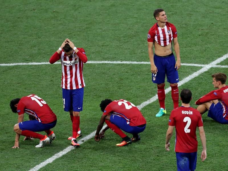 Atletico players react after Cristiano Ronaldo scored the winning penalty in a shoot out during the Champions League final football match between Real Madrid and Atletico Madrid at the San Siro stadium in Milan, Italy. (AP Photo)
