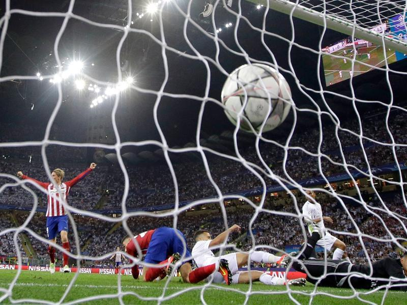 Atletico's Yannick Carrasco scores his side's first goal during the Champions League final football match between Real Madrid and Atletico Madrid at the San Siro stadium in Milan, Italy. (AP Photo)