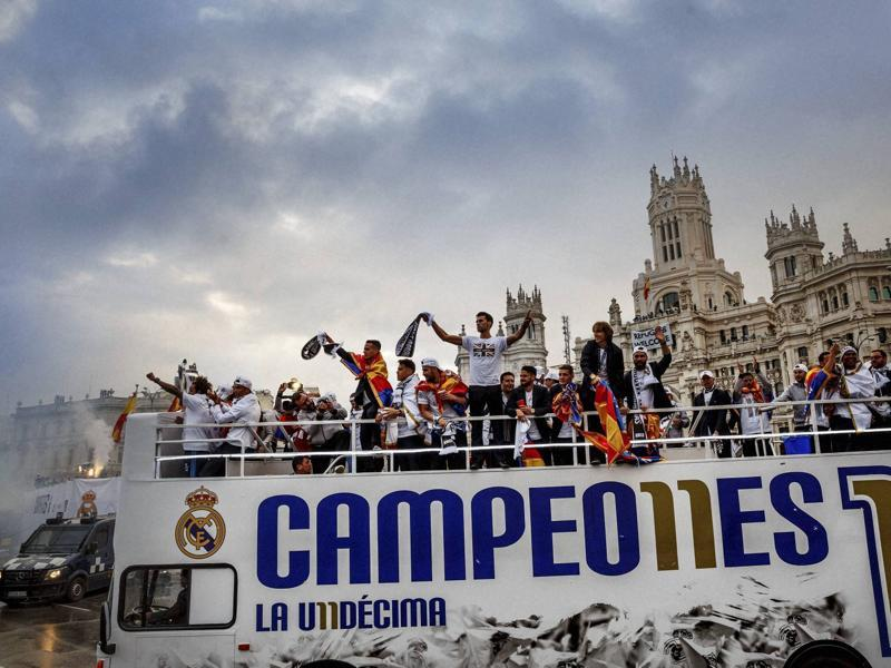Real Madrid players arrive at Cibeles square after winning the Champions League final football match between Real Madrid and Atletico Madrid, during a celebration parade in Madrid. (AP Photo)