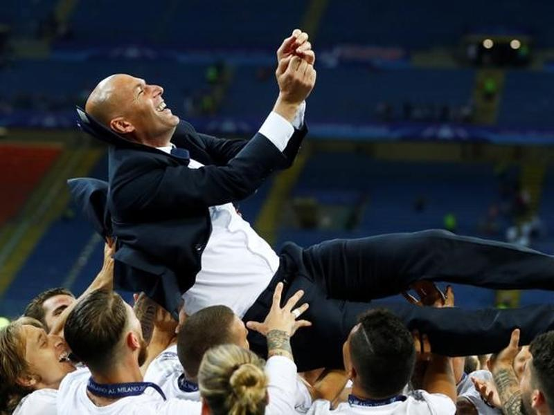 Real Madrid players give coach Zinedine Zidane the bumps as they celebrate winning the Uefa Champions League. (Reuters Photo)