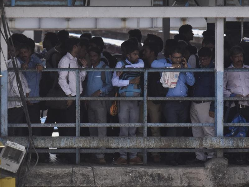 People wait for trains at Dadar station on Tuesday (Hindustan Times)