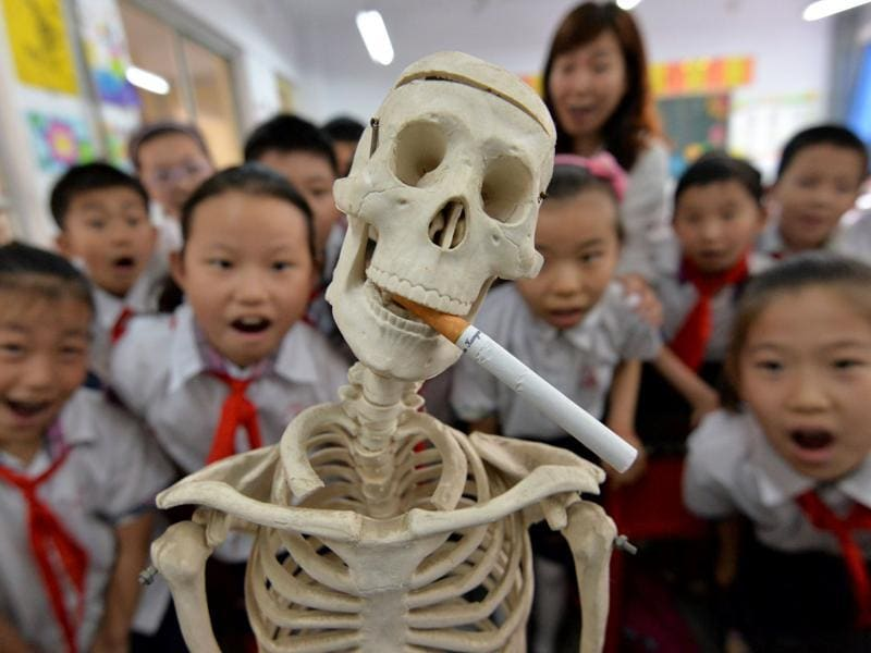 Students participating in the World No Tobacco Day campaign at a primary school in Handan, northern China's Hebei province. The slumping output of tobacco products in China is one of the factors responsible for the country's lowest industrial production rate in the first two months of the year since the global financial crisis.  (AFP)