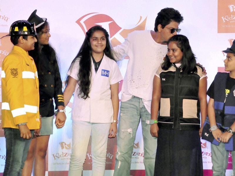 Shah Rukh Khan interacts with children at the launch of Kidzania in Noida on Tuesday. (PTI)