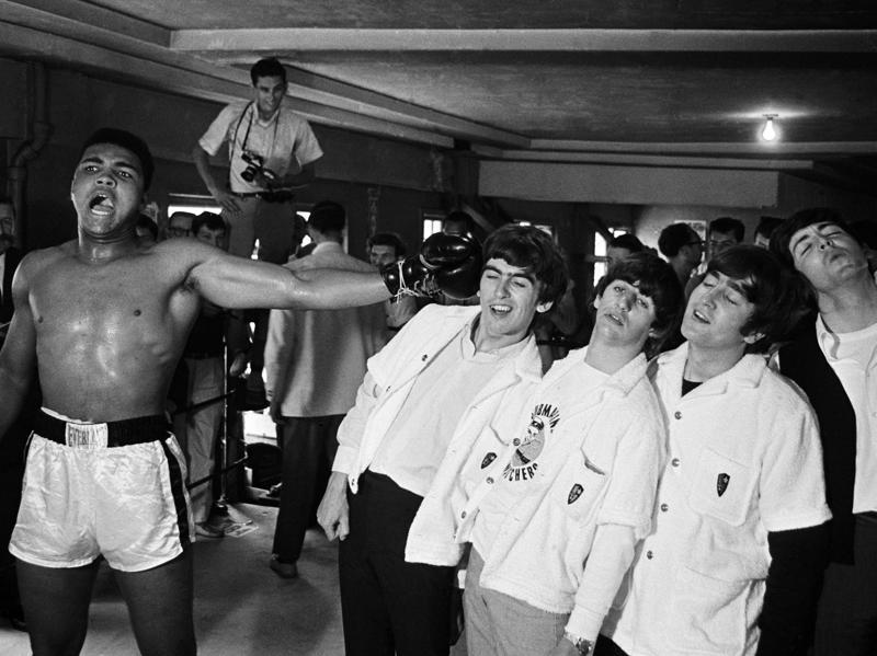 American heavyweight boxer Cassius Clay (later Muhammad Ali) takes on the Beatles. (Getty Images)
