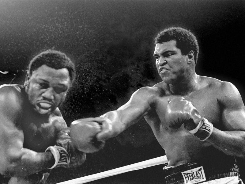 Muhammad Ali punches the head of challenger Joe Frazier. (AP Photo)