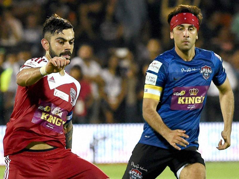 Ranbir Kapoor (R) and Virat Kohli in action during a charity football match in Mumbai. (PTI Photo)