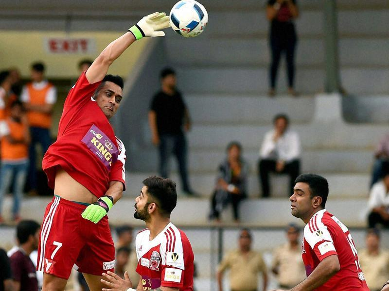 M S Dhoni, Virat Kohli and R Ashwin in action during a charity football match in Mumbai. (PTI Photo)