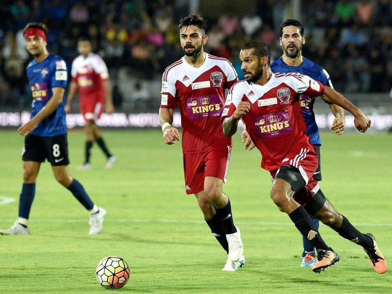 Ranbir Kapoor, Virat Kohli, Shikhar Dhawan and Dino Morea in action during a charity football match in Mumbai on Saturday. (PTI Photo)