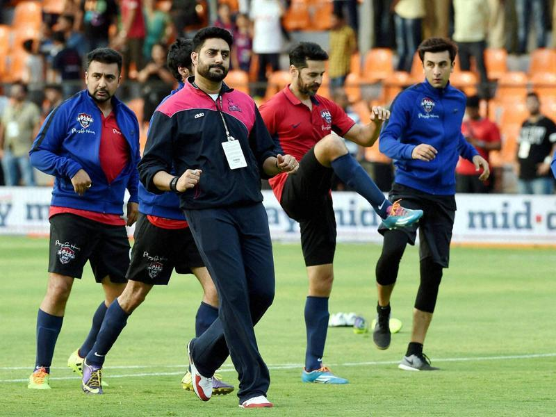Abhishek Bachchan, Ranbir Kapoor, Dino Morea in action during a charity football match. (PTI Photo)
