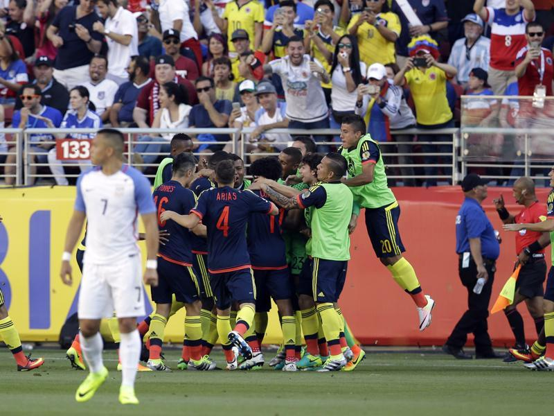 Colombia's players celebrate their team's first goal in a Copa America Centenario Group A football match against the US. (AP Photo)