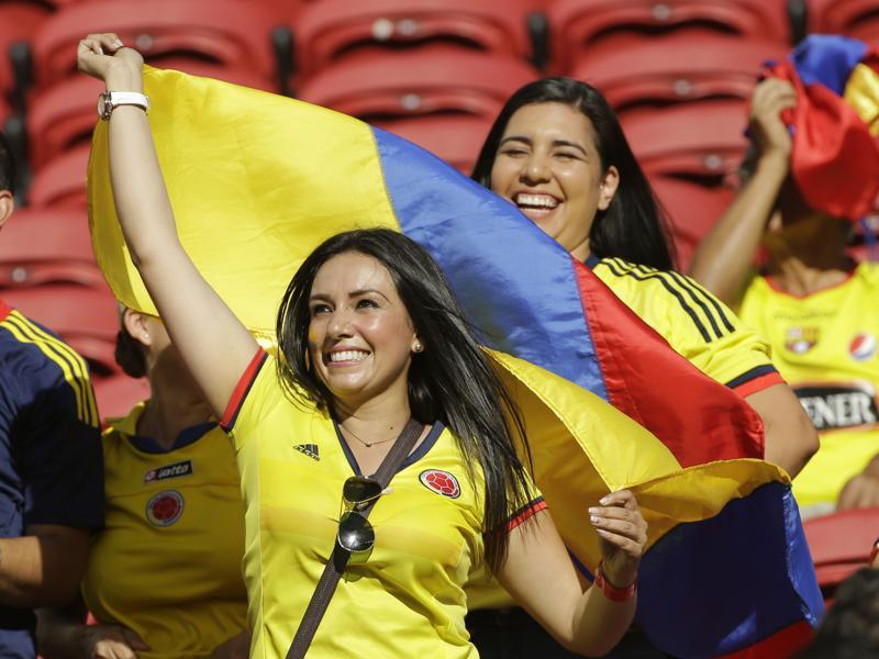 A fan waves the Colombia flag before the opening match of the Copa America Centenario. (AP Photo)