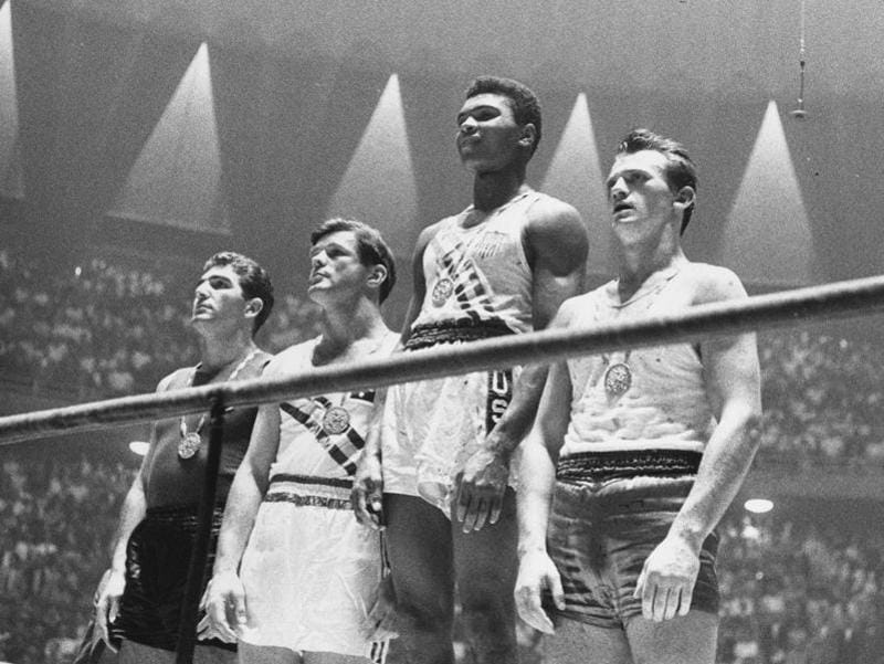 The winners of the 1960 Olympic medals for light heavyweight boxing on the winners' podium. (Getty Images)