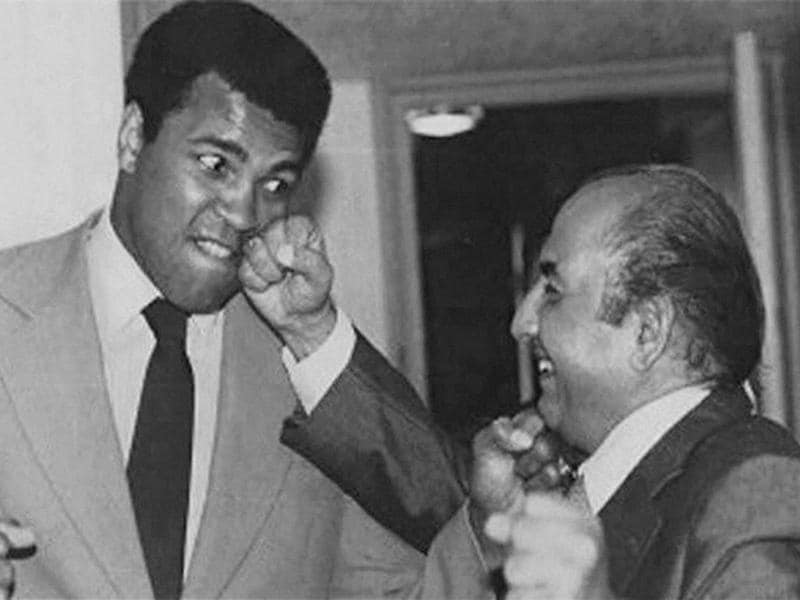 A file photo of late Music legend Mohammed Rafi with Heavyweight boxing icon Muhammad Ali. (PTI Photo)
