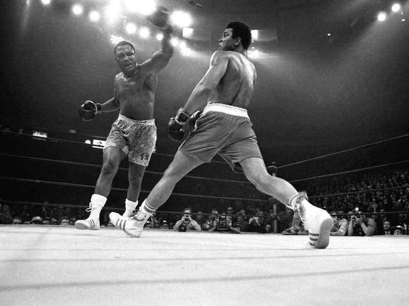 Muhammad Ali evades a left from Joe Frazier during their title bout. (NYT Photo)