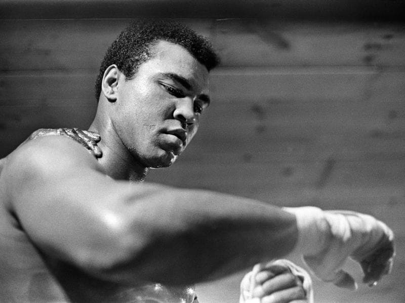 Muhammad Ali tapes his right hand for a training session at his camp in Deer Lake.  (NYT Photo)