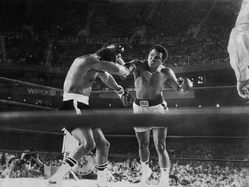 Muhammad Ali lands a punch on Ken Norton during their title bout at Yankee Stadium. (NYT Photo)