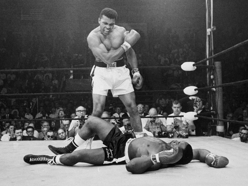 In this May 25, 1965, file photo, heavyweight champion Muhammad Ali, then known as Cassius Clay, stands over challenger Sonny Liston. (AP Photo)