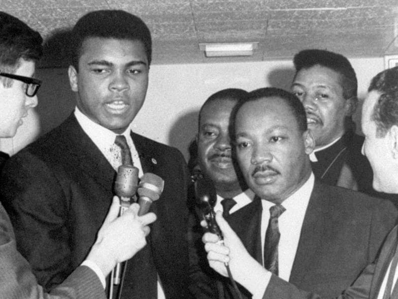 In this March 29, 1967, file photo, heavyweight champion Muhammad Ali, center left, and Dr. Martin Luther King speak to reporters. (AP Photo)