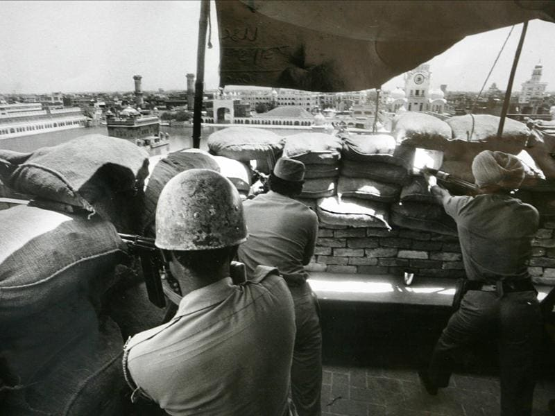 Army men take positions from a building adjoining the Golden Temple during the operation ordered by Indira Gandhi, the then prime minister, to remove Sikh separatists who were amassing weapons in the Temple in 1984. (India Today Group/Getty Images)