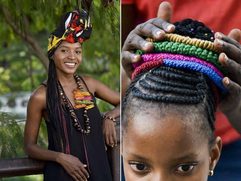 A young woman wears an Afro-Colombian hairstyle during the contest while a girl gets hers done. The hairstyles come in striking variety of colours and designs -- everything from coloured ribbons to appliqué flowers and even wooden buttons are incorporated. (AFP)