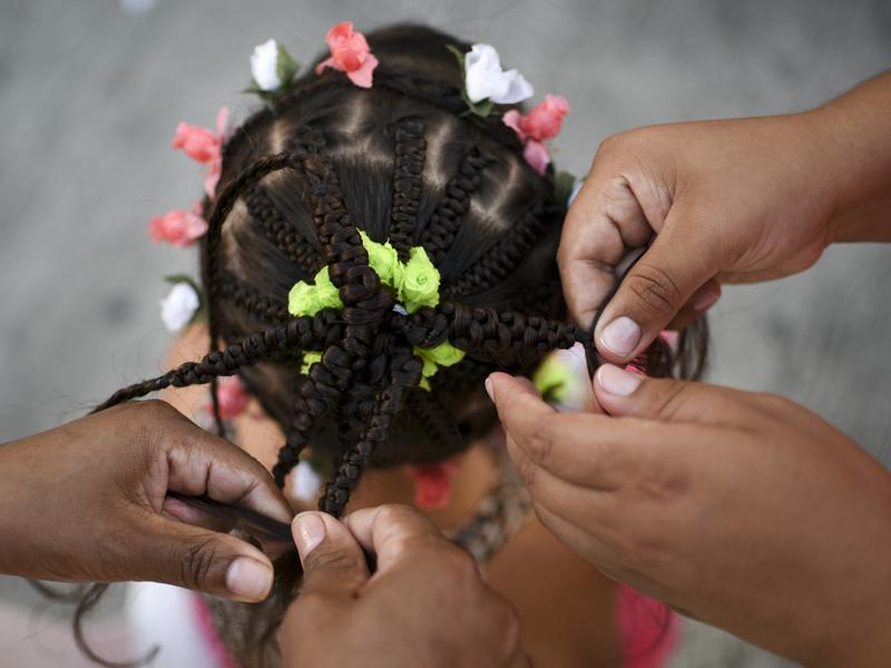 The contest seeks to revive African customs, identity and culture in Colombia.  A girl gets a hairstyle during the contest. Intricate braidwork, bright colours and bold designs are the hallmark of this style of hairdressing. (AFP)