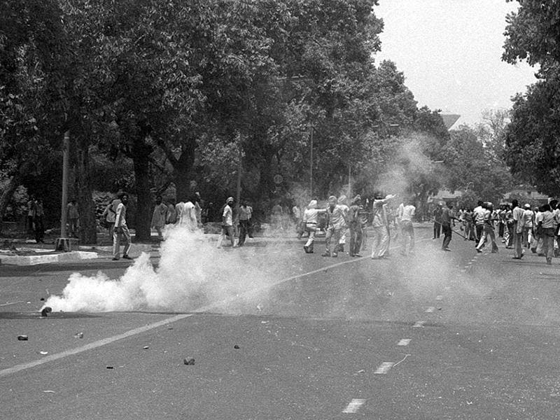 Police fire teargas shells to disperse the crowd pelting stones at police near Bangla Sahib Gurudwara in New Delhi. Sikhs were upset after the action in Golden Temple in June 1984 which the Sikh community felt was the desecration of Golden Temple by the Indian Army. (Ajit Kumar/HT File Photo )