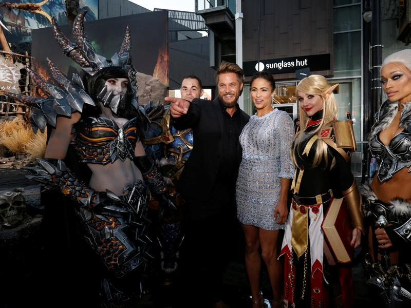 Cast members Paula Patton and Travis Fimmel pose with cosplay enthusiasts at the premiere of the Warcraft movie in Hollywood. (REUTERS)