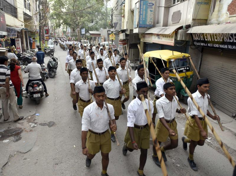 Volunteers parade through the streets during a training session.  (Sonu Mehta/HT Photo)