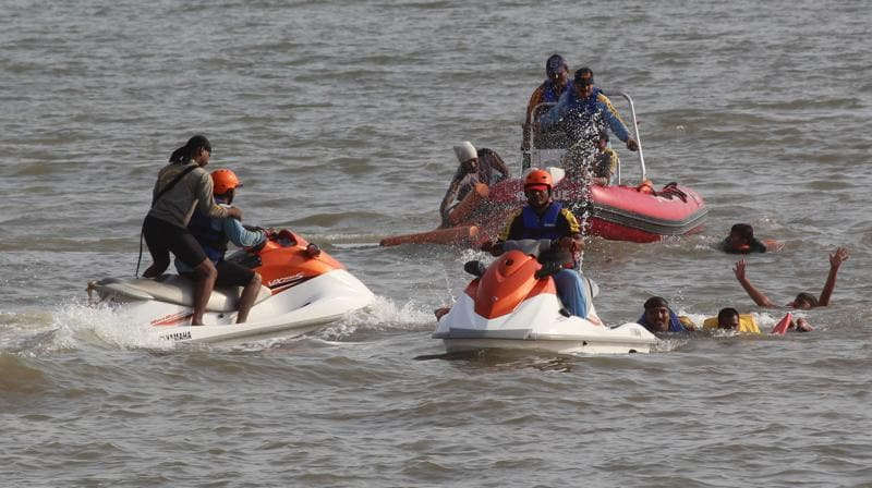 The  fire brigade has  11 permanent lifeguards  but they need help to man the city's six beaches.   (Satyabrata Tripathy)