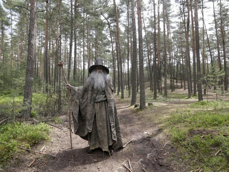 An enthusiast dressed as Gandalf from the fantasy novel The Hobbit by JRR Tolkien prepares for the battle of five armies near the town of Doksy, Czech Republic, Saturday, June 4, 2016.  (AP)