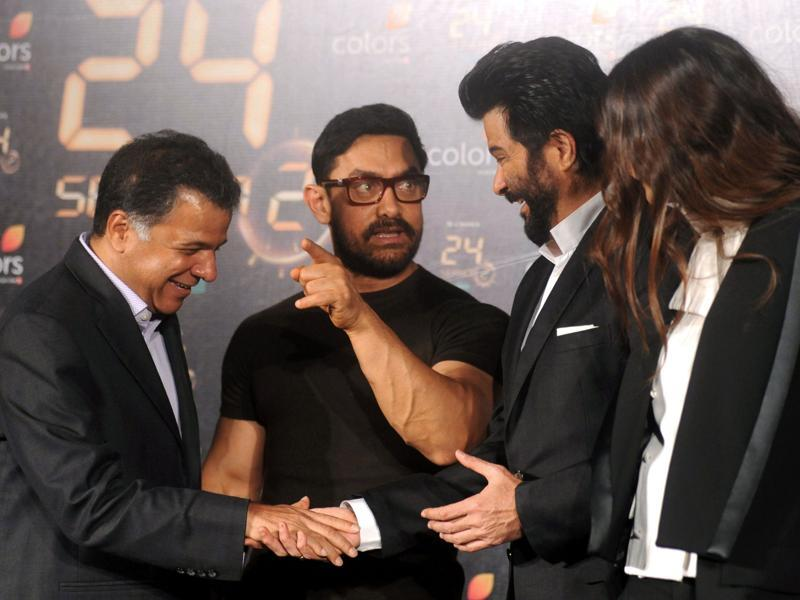 Sonam Kapoor looks on as actors Amir Khan and Anil Kapoor speak with Colors CEO Raj Nayak  during the trailer launch of 24 Season 2. (AFP)