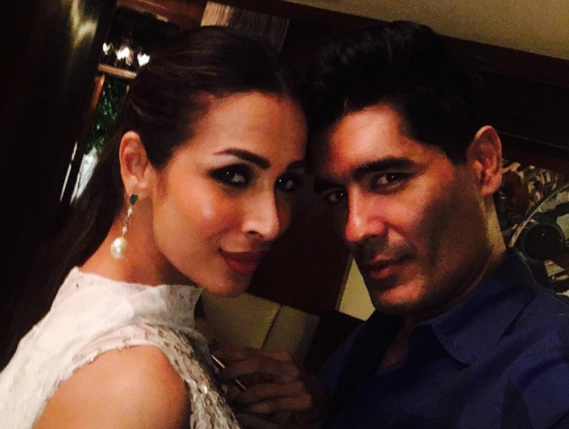 Manish Malhotra with Malaika Arora Khan. The designer took to Instagram to share pictures of his night out with the actors.