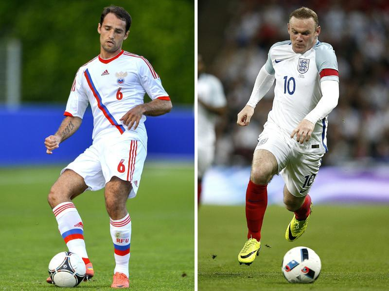 A combination of two file pictures shows Russia's midfielder and captain Roman Shirokov (L) and England's striker and captain Wayne Rooney. (AFP)