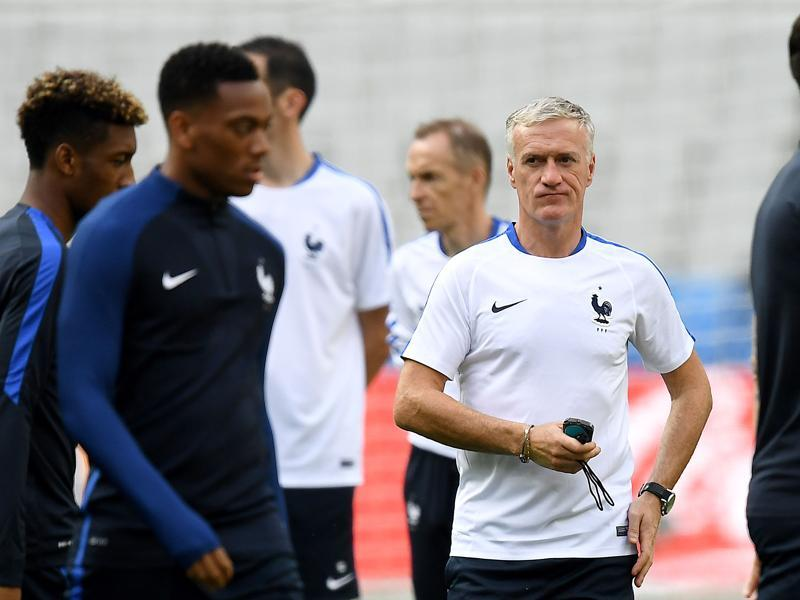 France's head coach Didier Deschamps (C) oversees the training. (AFP)