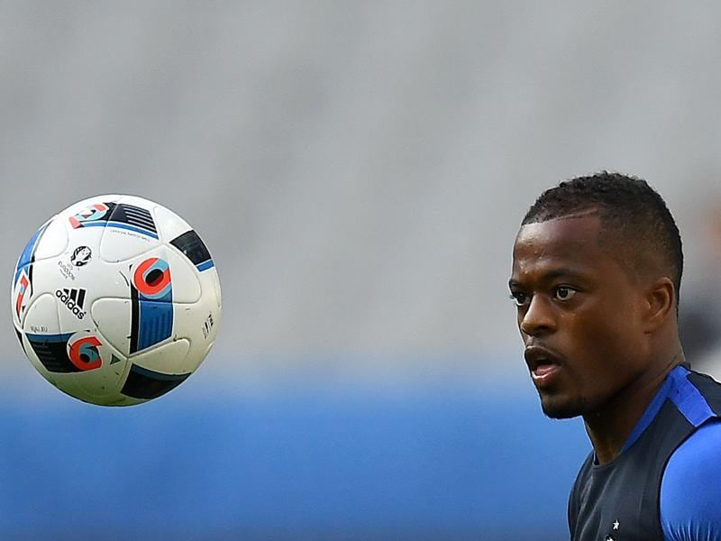 Defender Patrice Evra has his eye on the ball. (AFP)