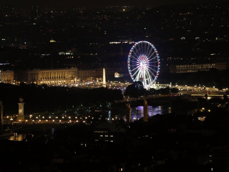 The Place de la Concorde is lit up in the red, white and blue of the French flag. (AP)