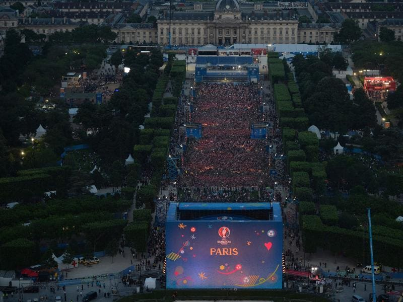 The fan zone on the Champs de Mars is thronged by people during the concert. (AFP)