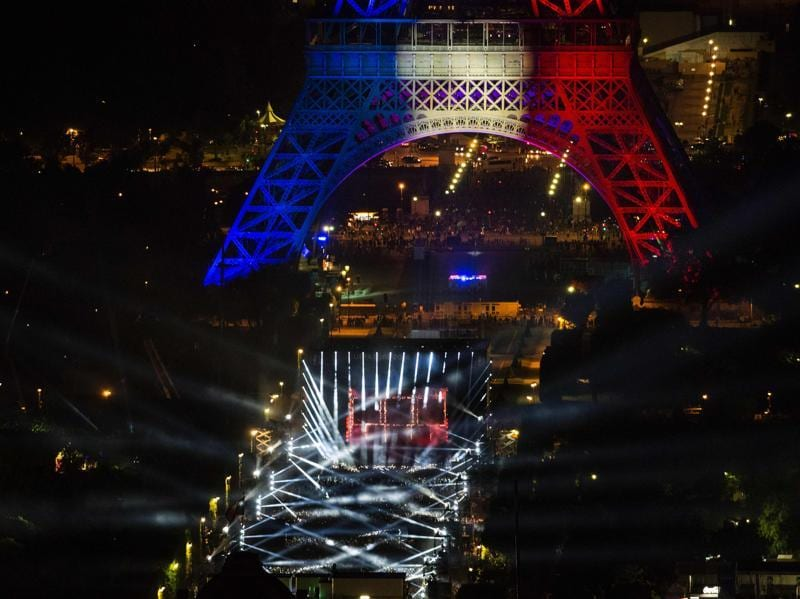 The Eiffel lit up in the colours of the French flag. (AFP)