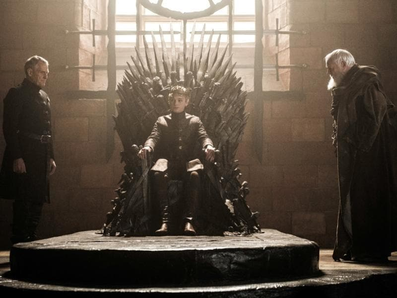 King Tommen, just chilling with Pycelle and Kevanin on the Iron Throne. That's all you'll do now boy.  (HBO)